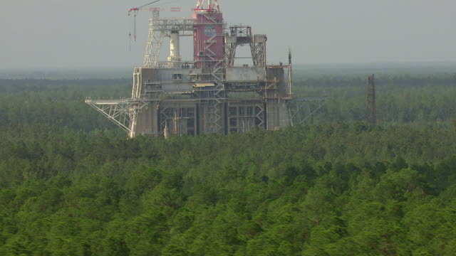 MS AERIAL TU Shot of forest with test stand at Stennis Space Center NASA rocket testing facility / Mississippi, United States