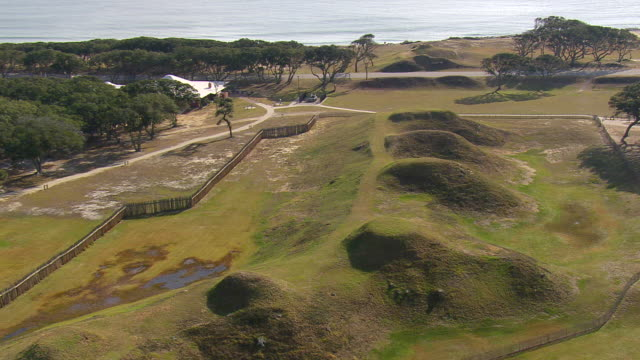 ms aerial zo tu shot of fort fisher area / north carolina, united states - tree fort stock videos & royalty-free footage
