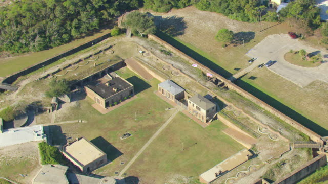 ms aerial zo shot of fort gaines and reveal waterfront / dauphin island, alabama, united states - civil war stock videos & royalty-free footage