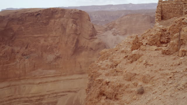 MS Shot of fortress at Masada and surrounding mountains in Negev desert / Israel