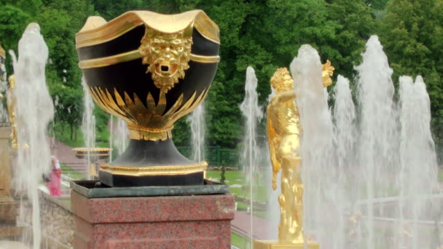 ms shot of fountain and statue in peterhof palace summer garden / st. petersburg, russia - st. petersburg russia stock videos & royalty-free footage