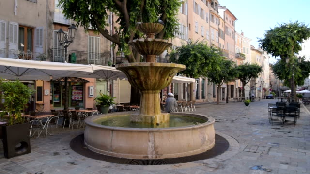PAN Shot of Fountain at Place aux Aires in old town of Grasse