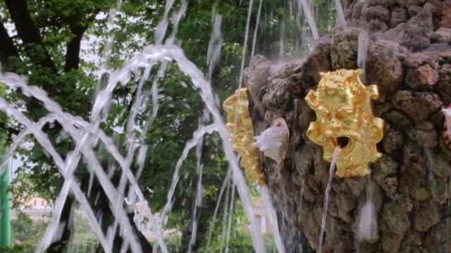 MS PAN Shot of fountain in Peterhof palace Summer Garden / St. Petersburg, Russia