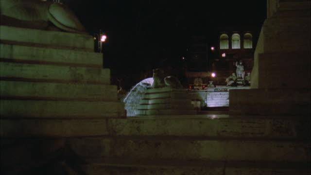 ms pan shot of fountain with lion statuary - rappresentazione di animale video stock e b–roll