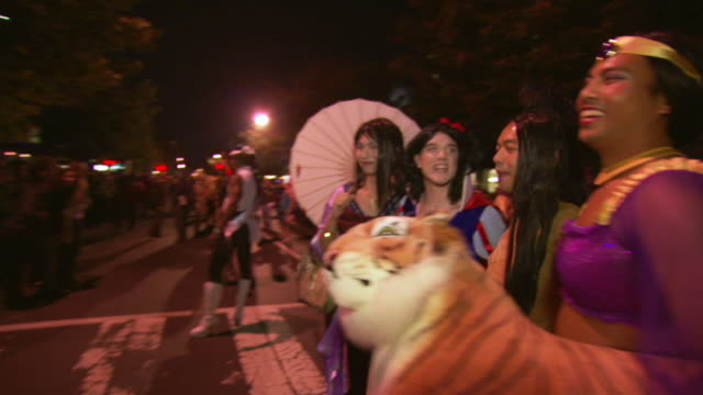 ms ts shot of four men wearing princess costumes poses during high heel race in dupont circle / washington, dist. of columbia, united states - dupont circle stock videos & royalty-free footage