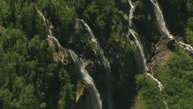 ms aerial zo shot of four waterfalls on side of mountain at glacier national park / montana, united states - glacier national park us stock videos and b-roll footage