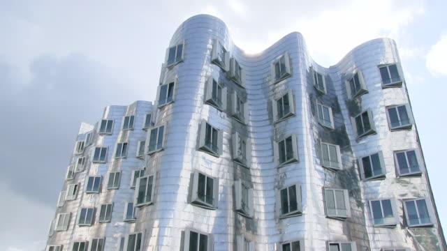MS Shot of Frank O. Gehry building at Medienhafen, Rhine / Dusseldorf, North Rhine Westphalia, Germany