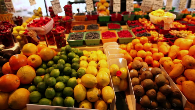 MS TU Shot of French fruit and vegetable stand in Atwater Market / Montreal, Quebec, Canada