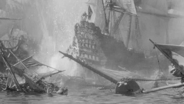 MS Shot of French ship under attack and being blown up in harbor