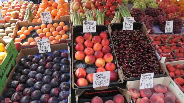 ms pan shot of fresh summer fruit stall in portobello market / london, united kingdom - fruit stock videos & royalty-free footage