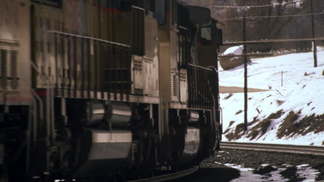 Shot of frieght train rounding a curve in wintertime.
