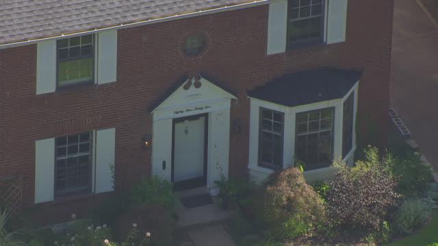 cu aerial shot of front door of home of roland doe / st louis, missouri, united states - exorzimus stock-videos und b-roll-filmmaterial