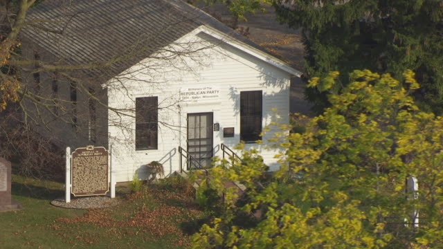 cu aerial zo shot of front entrance to little white schoolhouse where republic party was born / ripon, wisconsin, united states  - schoolhouse stock videos & royalty-free footage