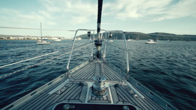stockvideo's en b-roll-footage met ws pov shot of front of boat moving towards harbor / south africa - jachtvaren