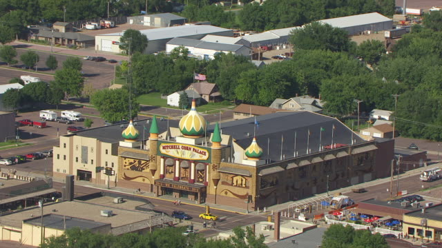 ms aerial ts zo shot of front of corn palace building / mitchell, south dakota, united states - onion dome stock videos and b-roll footage