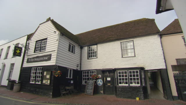 MS Shot of front part of exterior of pub / Alfriston, East Sussex, United Kingdom