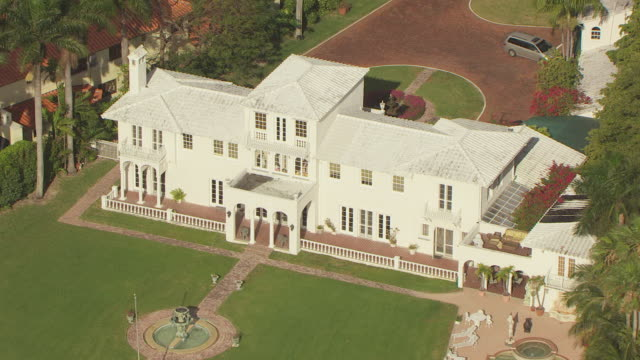 MS AERIAL Shot of front yard of Scarface Mansion on Star Island / Miami, Florida, United States