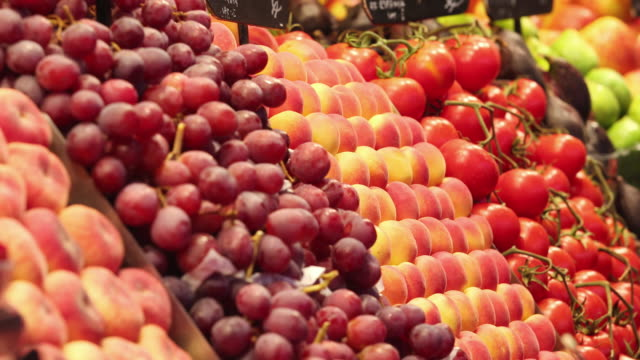 ms pan shot of fruit stand filled with fruit / seoul, south korea - red grape stock videos & royalty-free footage