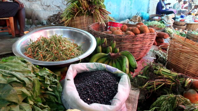 stockvideo's en b-roll-footage met ms shot of fruits and vegetables displayed for sale at marketplace on street / port-au-prince, haiti - haïti