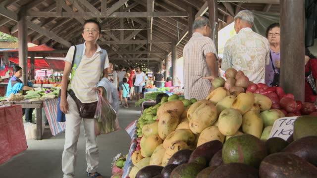 MS PAN Shot of Fruits at busy market / Kota Kinabalu, Sabah, Malaysia
