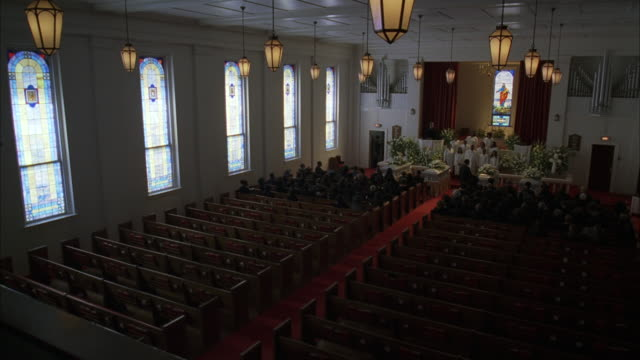 ms shot of funeral service in church / unspecified - funeral stock videos and b-roll footage