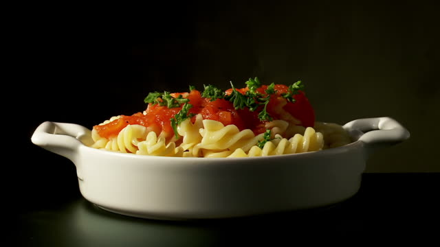 ms shot of fusilli pasta with tomato sauce pour on parsley, italian food - parsley 個影片檔及 b 捲影像