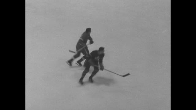 shot of game clock in maple leaf gardens / various action shots of hockey game between toronto maple leafs and detroit red wings interspersed with... - maple leaf stock videos and b-roll footage