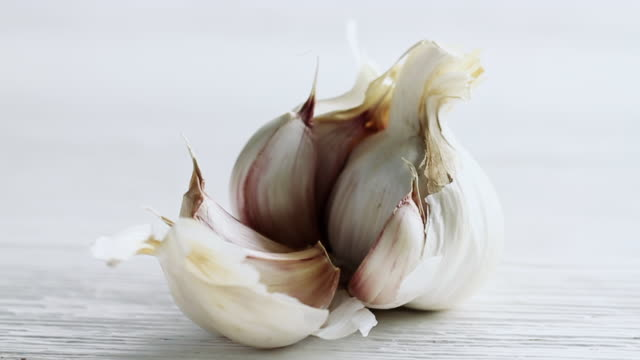 cu pan shot of garlic bulb / london, united kingdom  - garlic stock videos & royalty-free footage
