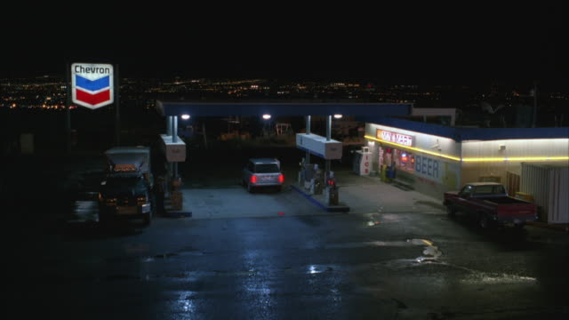 MS Shot of gas station with mini mart at night