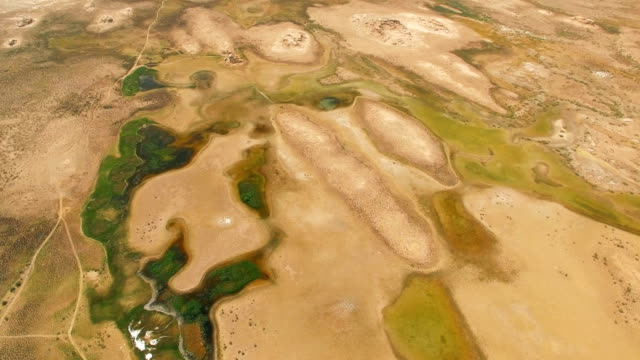 aerial shot of gebi desert,xinjiang,china. - desert oasis stock videos & royalty-free footage