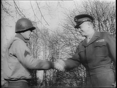 shot of general dwight d eisenhower standing and surrounded by his soldiers / shot of eisenhower shaking hands with one man while others wait in line... - esercito militare francese video stock e b–roll