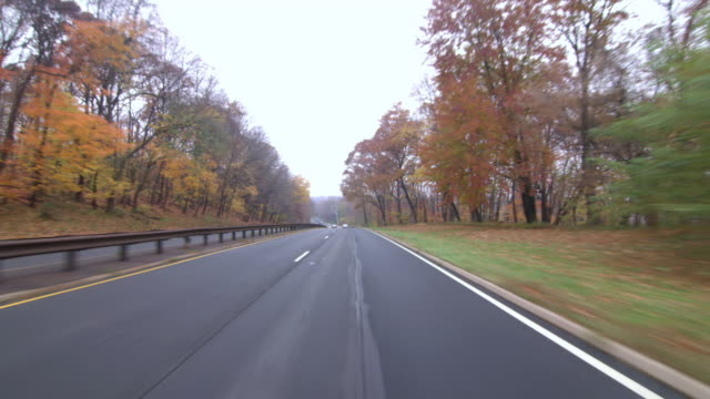 ms pov shot of george washington parkway with autumn leaves / mclean, virginia, united states - empty road stock videos and b-roll footage