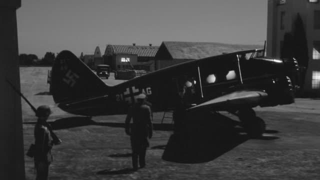 WS PAN Shot of German military base as German soldiers board plane