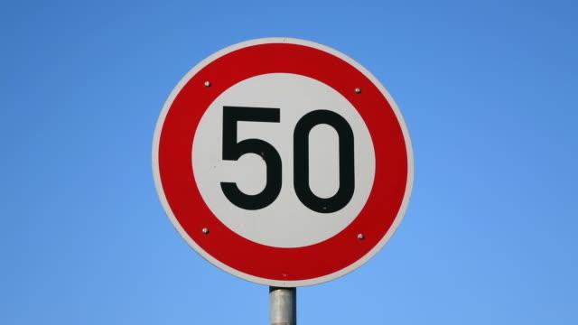 cu la shot of german traffic sign speed limit 50 km/h / faha, saarland, germany - verkehrsschild stock-videos und b-roll-filmmaterial