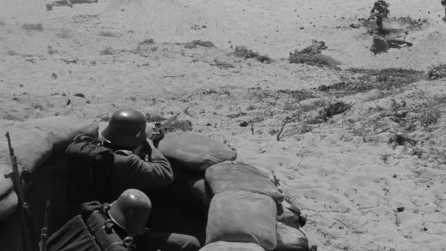 ms shot of germans in trench advance toward american soldiers climbing sea wall at omaha beach - omaha beach stock videos and b-roll footage