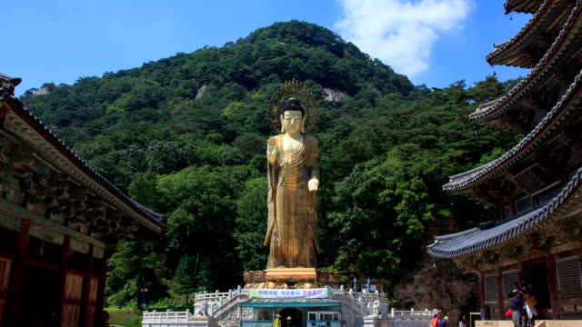 shot of geumdongmireukdaebul(bronze buddha statue, silla) and old architecture in beopjusa(temple) - buddha stock-videos und b-roll-filmmaterial