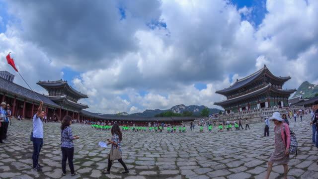 shot of geunjeongjeon(main throne hall, korea national treasure 223) and geunjeongmun gate at gyeongbokgung ancient palace - besichtigung stock-videos und b-roll-filmmaterial