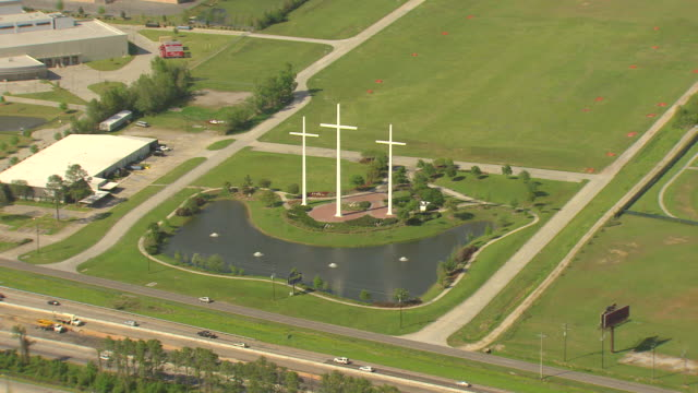 ms aerial shot of giant white crosses along highway in suburbs / baton rouge, louisiana, united states - religious cross stock videos & royalty-free footage