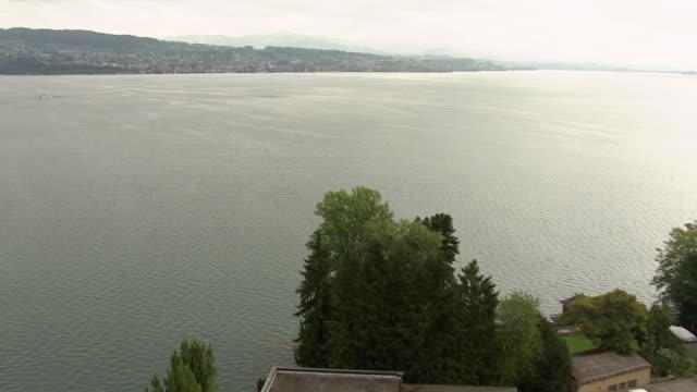 MS AERIAL Shot of Giessen at lakeside of lake zurich near wadenswil / Wadenswil, Zurich, Switzerland