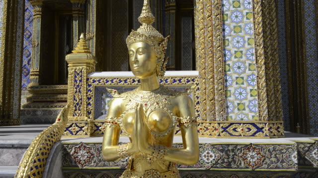 MS Shot of gilded kinnari figure in wat phra kaeo temple in grand palace / Bangkok, Thailand