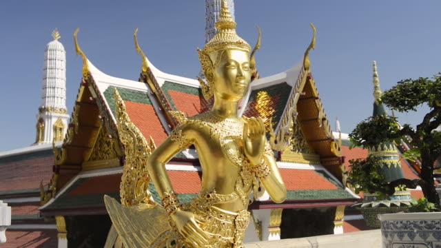 CU Shot of gilded kinnari figure in wat phra kaeo temple in grand palace / Bangkok, Thailand