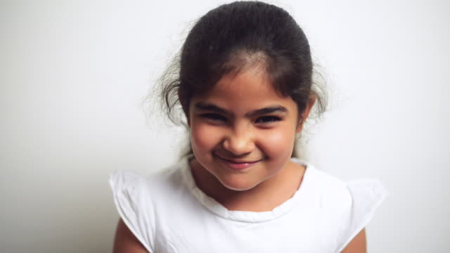 stockvideo's en b-roll-footage met cu shot of girl making her face funny / gurgaon, haryana, india - actrice