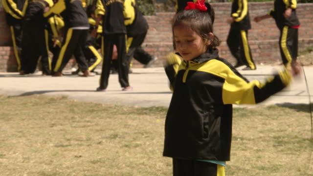 shot of girl playing skipping of papa's house / kathmandu nepal - waisenhaus stock-videos und b-roll-filmmaterial