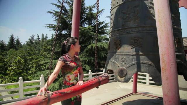MS Shot of girl ringing bell / Xian, Shaanxi, China