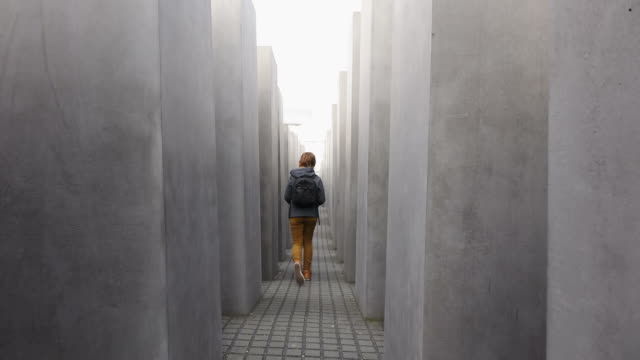 ms shot of girl walking at holocaust memorial, memorial to murdered jews of europe / berlin, germany - memorial stock videos & royalty-free footage