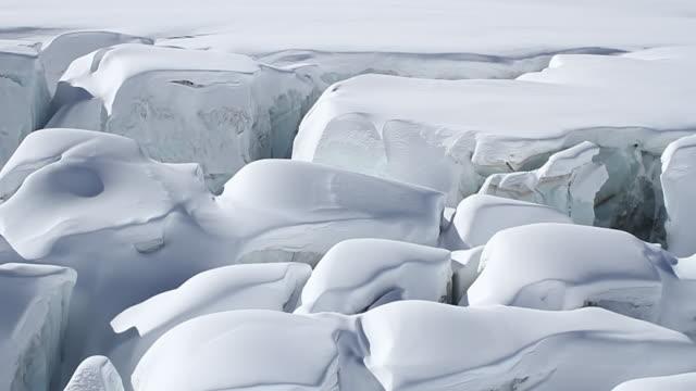 ms aerial shot of glacial crevasses, mont blanc / chamonix, haut savoir, france  - mont blanc stock videos & royalty-free footage