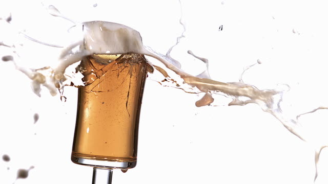 ms slo mo shot of glass of beer breaking and splashing / vieux pont, normandy, france - empty beer glass stock videos and b-roll footage
