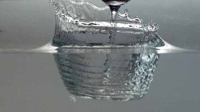 ecu slo mo shot of glass of red wine falling into water/ seoul, south korea - bicchiere video stock e b–roll