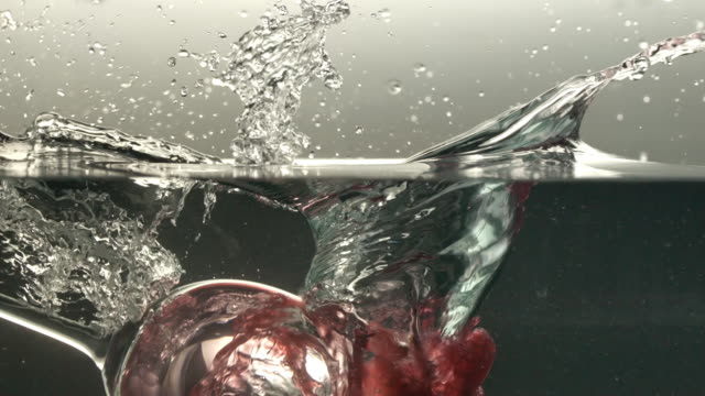 ECU SLO MO Shot of glass of red wine falling into water/ Seoul, South Korea