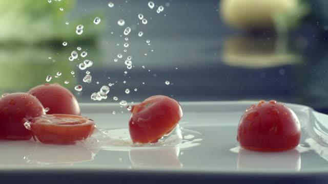 ecu slo mo shot of glass of red wine falling into water/ seoul, south korea - fem objekt bildbanksvideor och videomaterial från bakom kulisserna